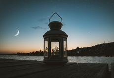 Gray Metal Candle Lantern on Boat Dock royalty free stock images