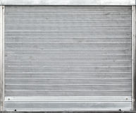 Gray metal garage gate with rolling shutters Stock Images