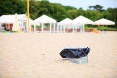 Gray metal garbage bin or can on beach. Gray metal garbage bin or trash can with a plastic bag inside beach outdoor Stock Photos