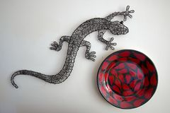 Gray Metal Gecko and Red Chili designed bowl Royalty Free Stock Photo