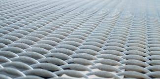 Gray metal mesh surface Stock Photos