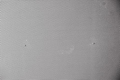 Gray metal plate with dots and screws Stock Image