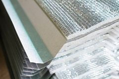Gray Metal sheets Roofing. Gray Metal sheets Roofing with sun shield polyethylene foam insulation PE foam stock photos