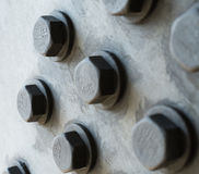Gray metal surface with hexagonal bolt heads Stock Photography