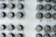 Gray metal surface with hexagonal bolt heads Royalty Free Stock Images