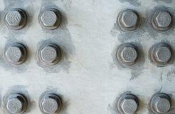 Gray metal surface with hexagonal bolt heads Stock Photos