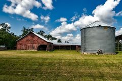 Gray Metal Water Tank Under Clear White Blue Sky during Daytime Royalty Free Stock Photo