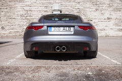 Gray metallic Jaguar F-Type coupe, back view royalty free stock photography