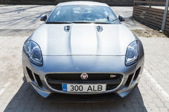 Gray metallic Jaguar F-Type coupe, frontal view Royalty Free Stock Photos