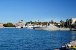 Gray metallic warship in a sea port Stock Photos