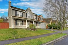 Gray mixed siding home with nice landscaping. Gray mixed siding home exterior with nice landscaping on a perfect sunny day royalty free stock photos