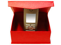 Gray mobile telephone and red cardboard box. Gray (silver) mobile (radio) telephone and red cardboard box on isolated background royalty free stock photos