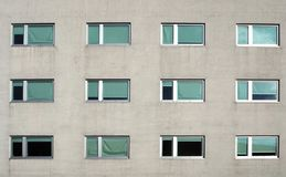 Gray modern building facade with new pvc windows. Front view royalty free stock photography