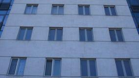 Gray modern building facade with new pvc windows stock photos