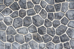 Gray mosaic stone wall background. Nice stones with a very special and individual pattern Stock Photography