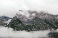 Gray Mountain Surrounded by Clouds Stock Photos