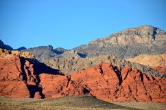 Gray Mountains, Red Mountains, Tan Mountains all together. A grouping of various colors of mountains, a history of time Stock Image