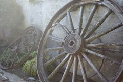 Gray Multi-spoke Wheel Leaning on Wall Stock Photo