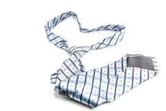 Gray necktie on a white background Royalty Free Stock Images