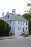 Gray new england house. Small gray house with a clock cupola.  The house is in the quaint town of Stonington Connecticut Stock Image