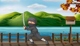 A gray ninja with a sharp sword near the wooden mailbox Stock Photos
