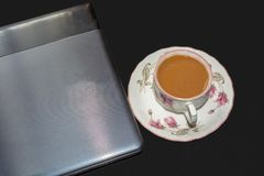 Gray notebook and cup of tea on black isolated background. royalty free stock photos