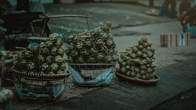 Gray Nuts With Three Baskets on Gray Table Stock Photos