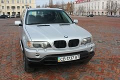 Chernigov, Ukraine - November, 2017. Gray off-road car BMW X5. A private car parked on the sidewalk. Gray off-road car BMW X5. A private car parked on the royalty free stock photography