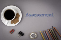 Gray office desk with the inscription - Assessment Royalty Free Stock Photo