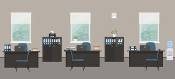Gray office room with black desks and blue chairs. Office room in a gray color. There are black desks, blue chairs, a printer, a water cooler, cabinets for Stock Photos