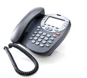 Gray office telephone. Isolated on a white background Stock Photography