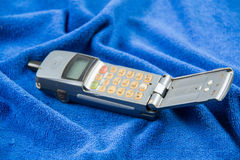 Gray old mobile phones. Solid color background and shabby gray old mobile phones Stock Photos