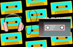 Gray old retro vintage hipster portable music cassette audio player for audio cassettes from the 80`s, 90`s and headphones on th. E background of audiocassettes Royalty Free Stock Photo