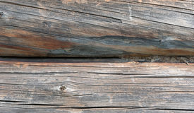 Gray old sawed wood logs of wooden house closeup Stock Images