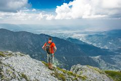 Gray and Orange Backpack Worn by Man at Mountain Stock Photos