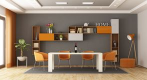 Gray and orange dining room stock photography