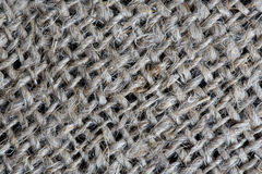 Gray organic burlap fabrics. Closeup. Background royalty free stock photography