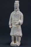 Gray oriental man statuette over black background Royalty Free Stock Images