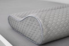 Gray orthopedic pillow. Made of memory foam on the bed. Slose-up shot royalty free stock photo
