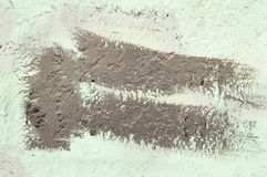 Gray paint brush stripe on a gray wall - background. Texture royalty free stock images
