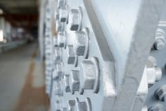 Gray painted hexagonal bolt heads Stock Images