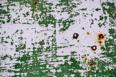 Gray painted metal wall with cracked green paint, rust stains, sheet of rusty metal with cracked and flaky green paint. Metal background for design with copy royalty free stock photos