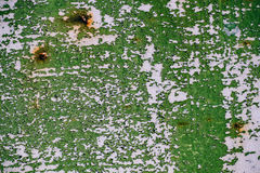 Gray painted metal wall with cracked green paint, rust stains, sheet of rusty metal with cracked and flaky green paint , metal bac Stock Photo