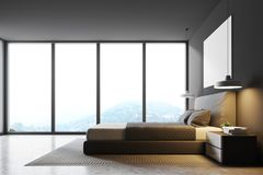 Gray panoramic bedroom, side view. Gray panoramic bedroom interior with a concrete floor, a double bed and a magnificent window view. A poster on the wall. 3d Stock Photos