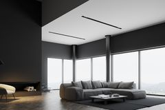 Gray panoramic living room, fireplace. Gray panoramic living room interior with a fireplace, a wooden floor and a gray sofa near a round coffee table. 3d Stock Images