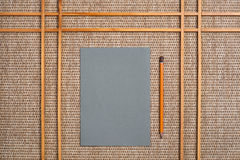 Gray paper and pencil on background Royalty Free Stock Photos