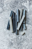 Gray pastels on a stone background Royalty Free Stock Photos