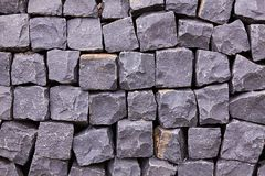 Gray pavement background. Pavement texture. Granite cobblestone pavement royalty free stock images