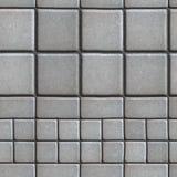 Gray Paving Slabs Lined mit Quadraten von unterschiedlichem Stockfotografie