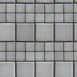 Gray Paving Slabs Lined mit Quadraten von unterschiedlichem stockbild